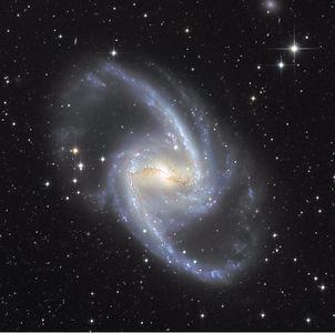 """Galaxie spirale barrée spectaculaire, NGC 1365 va nous servir d""""introduction à la dynamique des barres galactiques."""