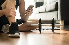 man-using-smartphone-during-workout-260n