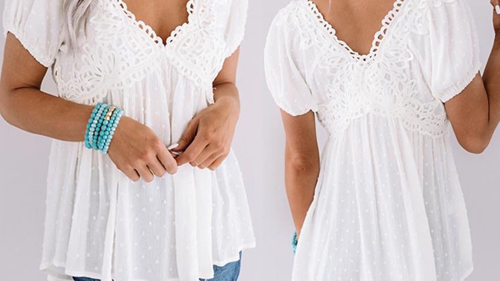 White pom pom crocheted tunic blouse