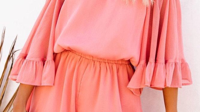Pink flounce off shoulder romper