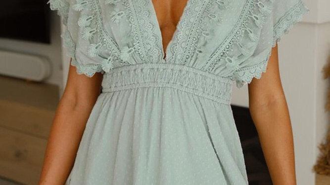 Green lace ruffled open back dress