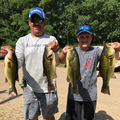 Jason and Jackson Rosati with a nice bag on Whitefish Chain 2019