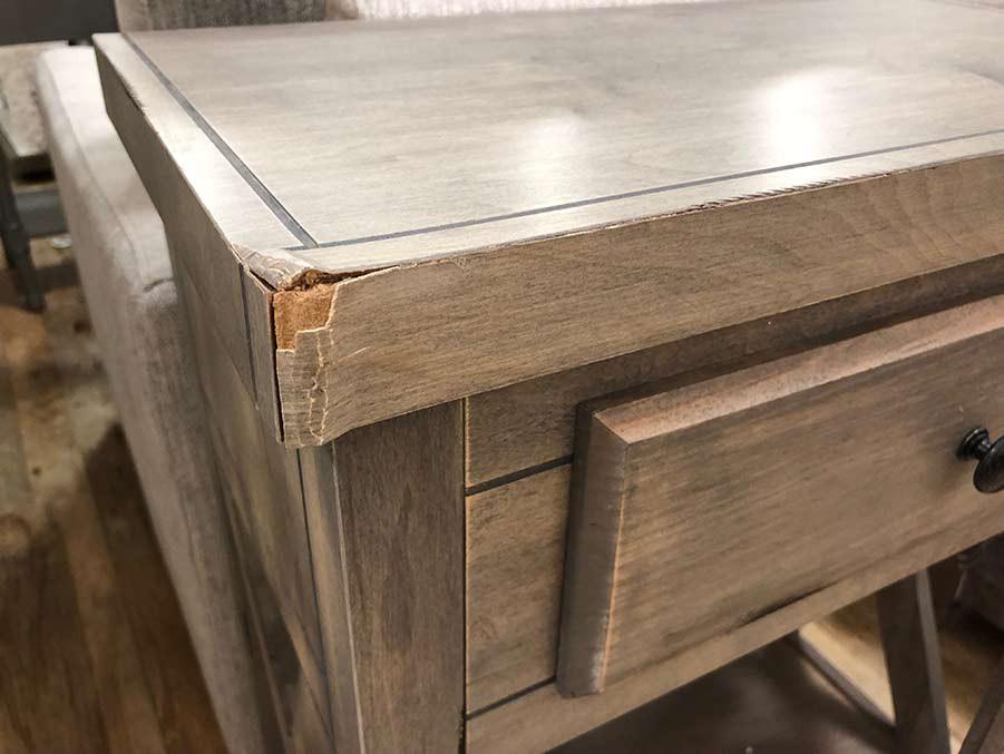 Damaged veneer on a mass-produced desk