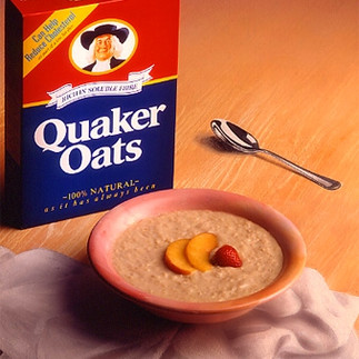 painted wooden surface, fabric and spoon for Quaker Oats