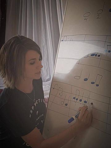 Terrah teaching fundamentals of music in the Hornlee community
