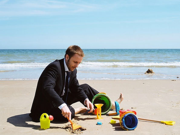 man-in-suit-playing-on-beach_edited.jpg