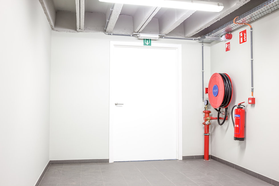 Fire extinguisher in a room.jpg