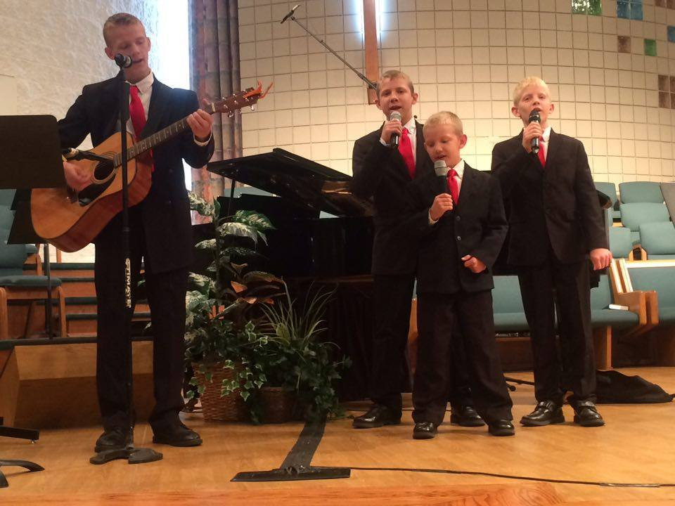 The four boys singing at Great-Grandma Rosie's funeral