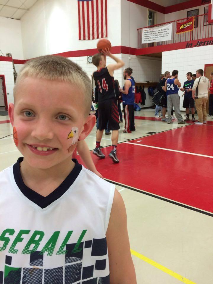 JohnPaul rooting for the Howardsville team!