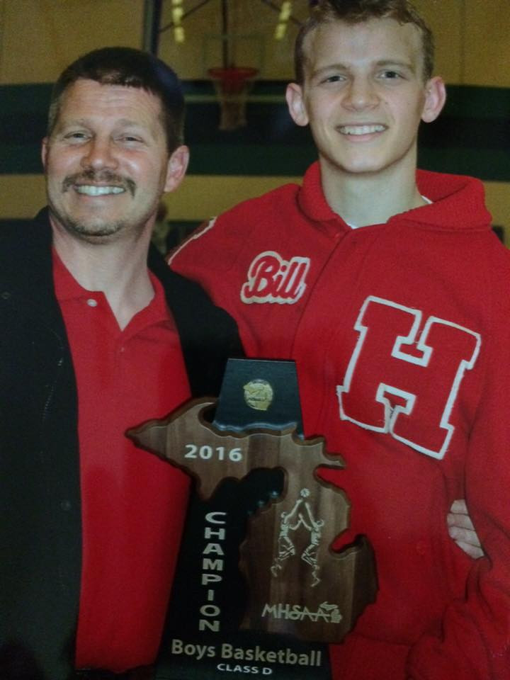 Bill and Jordan celebrating the basketball district victory!