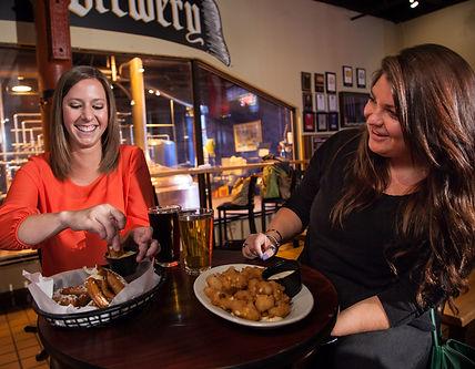 Two girls enjoying meal at Penn Brewery