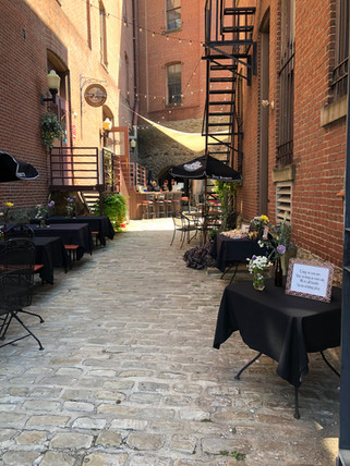 The Biergarten tables and brick walls