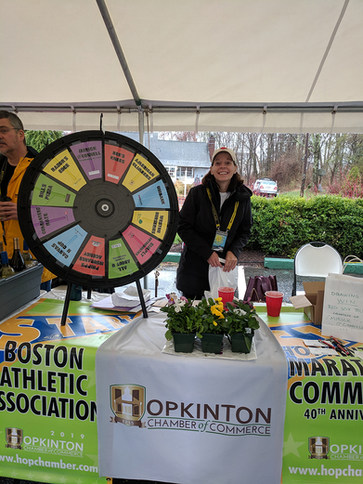 Sharon MacDonald from All About U spinning the Wheel at the Chamber Table.