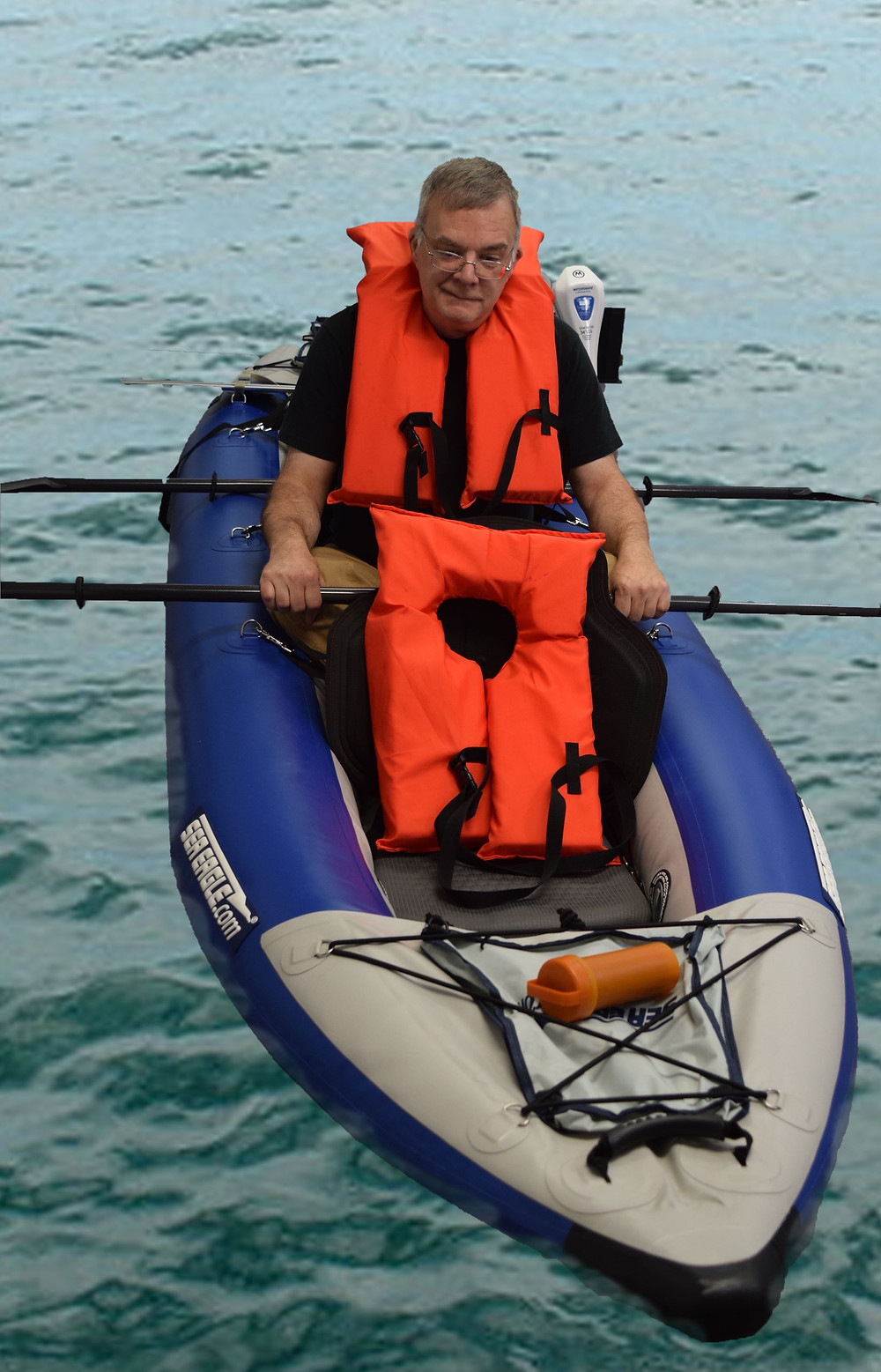 Man in inflatable kayak, thinking about selling it.
