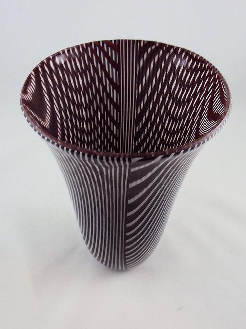 Black, white, red drop vessel