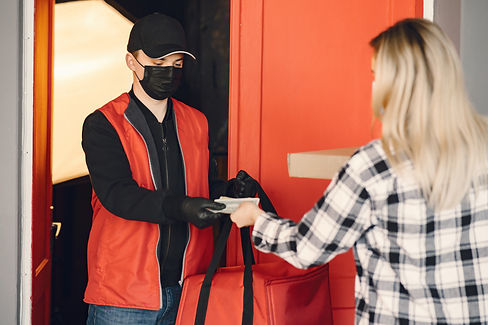 delivery-man-in-a-medic-mask-with-woman-CPFVWXA.jpg