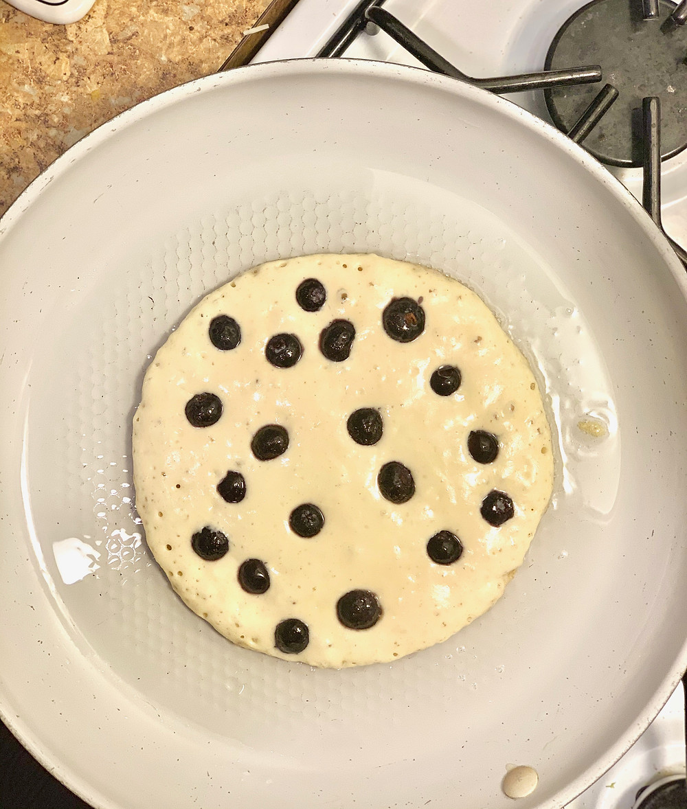 GF Blueberry Pancake cooking in pan