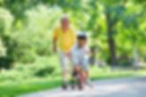 Grandpa, kid and bike