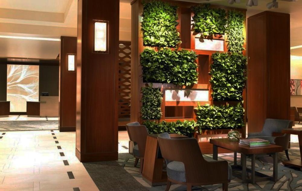 Jardines verticales para modernizar los muebles del salón