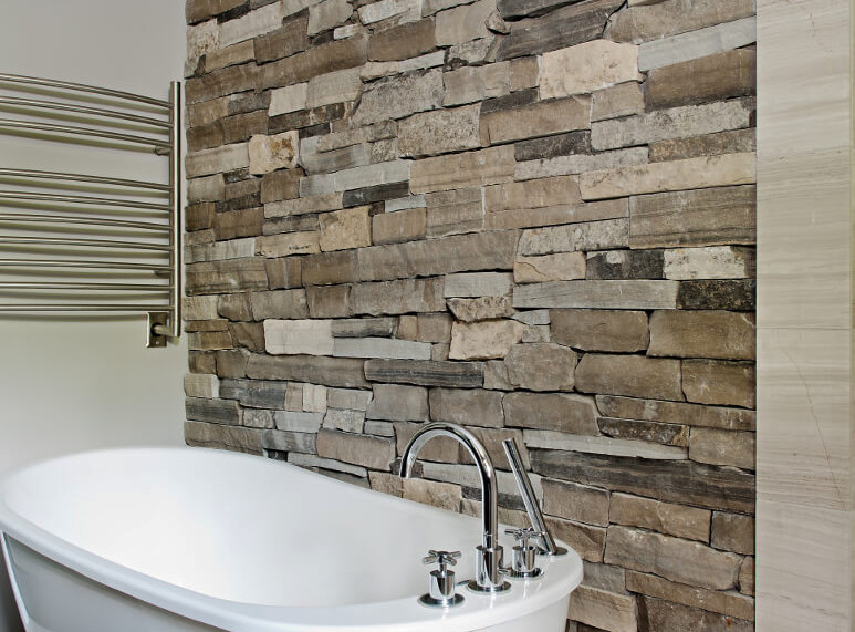Paneles premontados de piedra natural en el baño