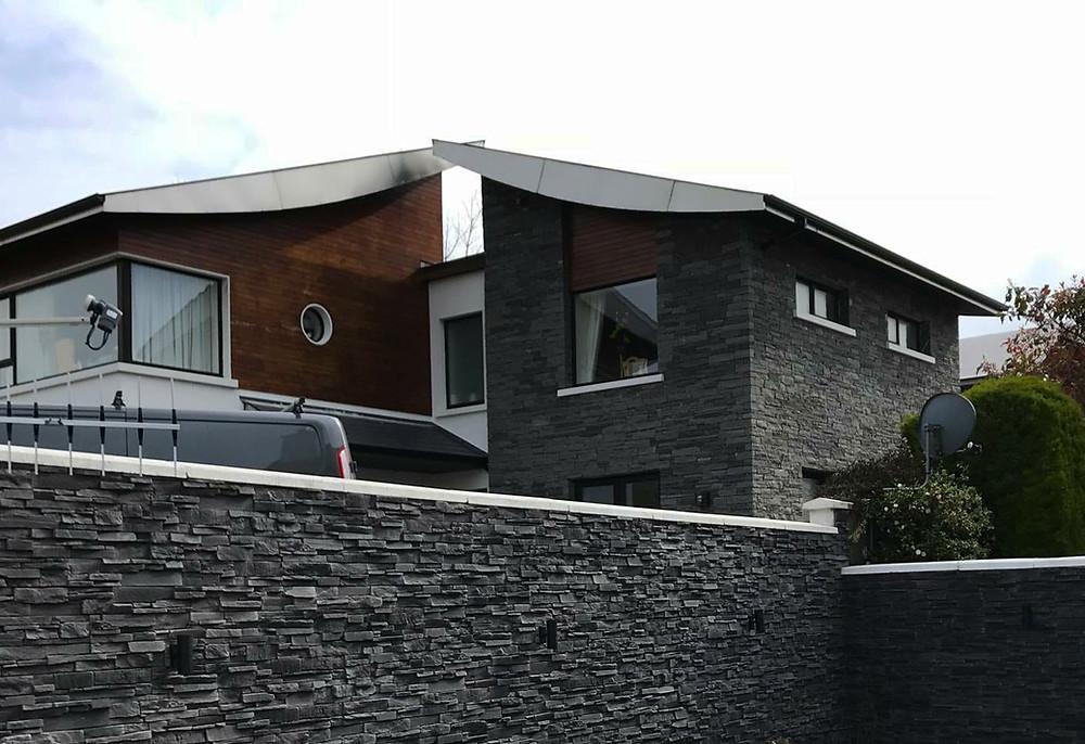 Paneles premontados de piedra natural en fachadas