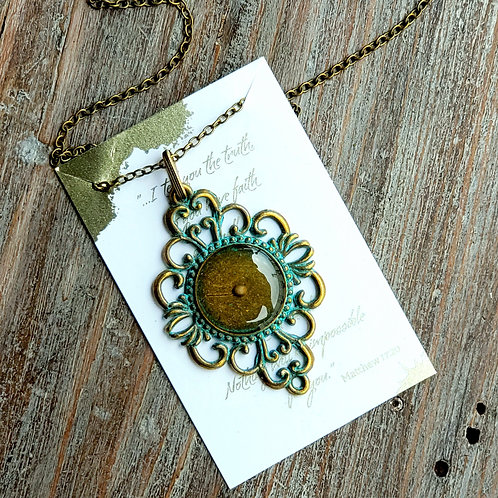 Mustard seed necklace in bronze and resin, bronze filigree with patina