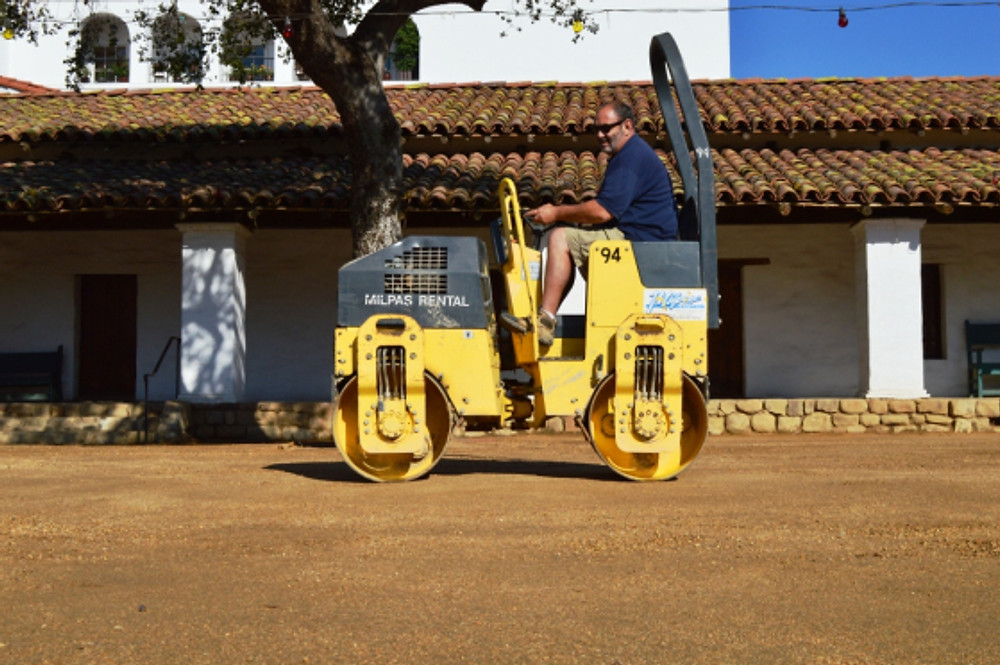 Compacting the decomposed granite with a vibrating roller/compactor. Photo by Michael Imwalle.
