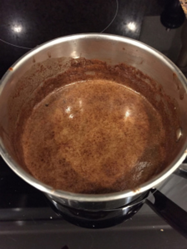 The consistency of the icing should be similar to the stovetop mixture for the cake batter. If you use real cane sugar the consistency will be grainier than using brown sugar.  Photo by Brittany Avila.