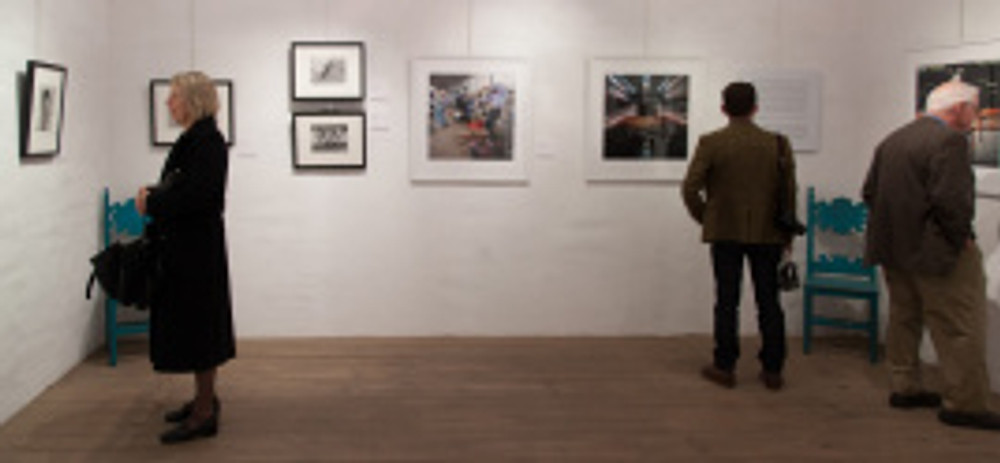 Visitors in the gallery at Casa de la Guerra on opening night. Photo by Fritz Olenberger.