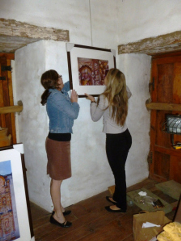 Anne Petersen and SBTHP office manager Brittany Avila installing the Junipero Serra in Mexico exhibit at Casa de la Guerra. Photo by Mike Imwalle.