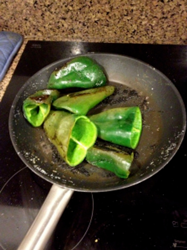 You'll hear hissing noises as the chiles simmer on the stove, but don't worry, this is just the chilies' way of saying they're cooking! Photo by Brittany Avila.