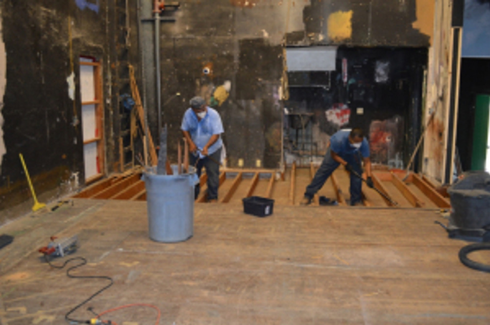 Exposing the theater's original stage floor. Photo by Michael Imwalle.