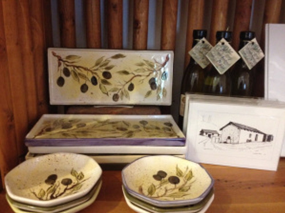 Olive-themed trays and bowls made by ceramic artist Jeannie Davis for sale exclusively through SBTHP. Photo by Katie Sorensen.