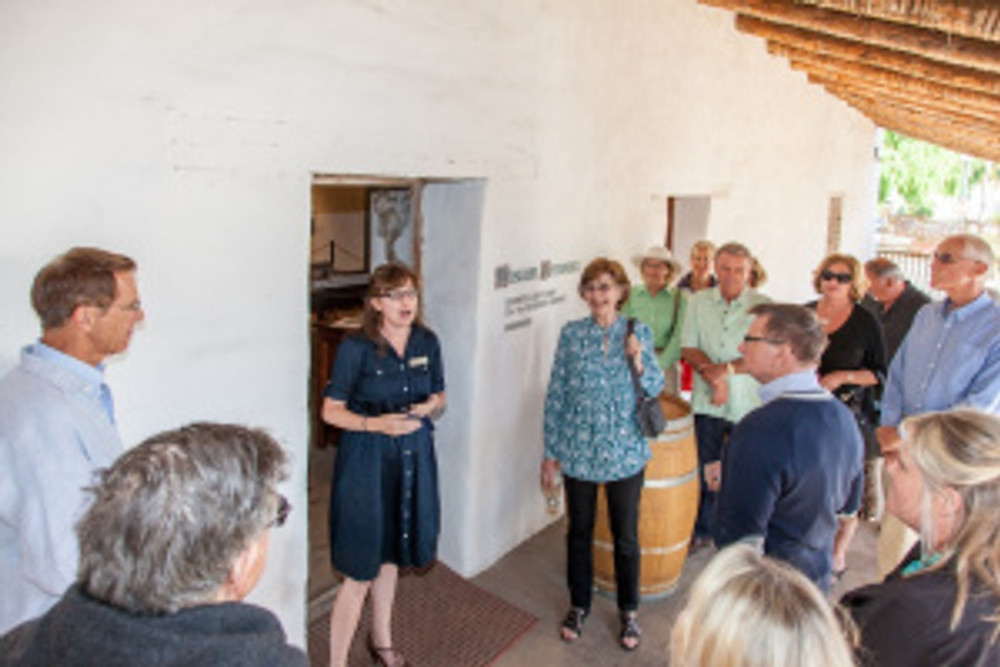 Dr. Anne Petersen beginning her tour of Casa de la Guerra. Photo by Frtiz Olenberger.