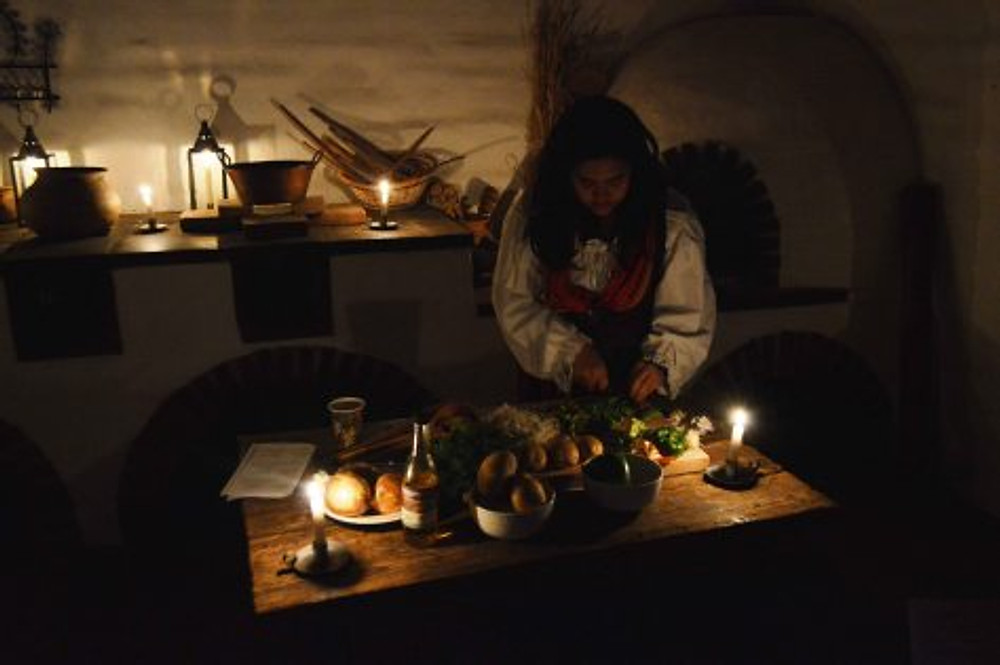 Hazel Lamson prepares a meal in the cocina. Photo by Mike Imwalle.