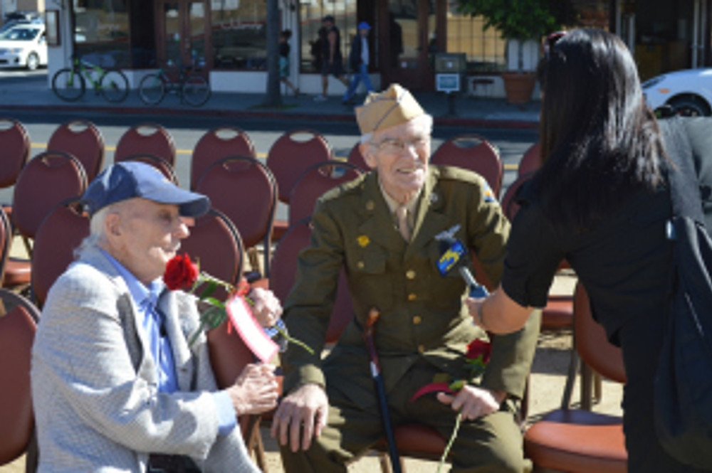 WWII veterans and long-time SBTHP supporters Walter C. Douglas and James Mills intereviewed at the ceremony by KEYT News. Photo by Michael H. Imwalle.