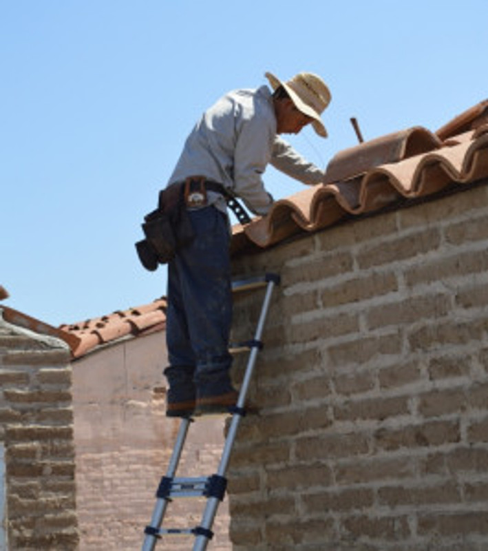 Finishing the tile cap. Photo by Mike Imwalle.