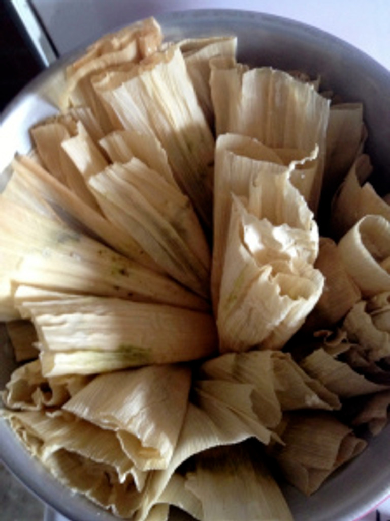 Place the tamales standing upright, with the slitted top facing upwards. I began by lining my pot with them, and worked in a circle with them towards the middle of the pot. Photo by Brittany Avila.