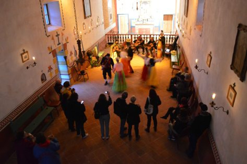 Dancers entertain in the Presidio Chapel. Photo by Mike Imwalle.
