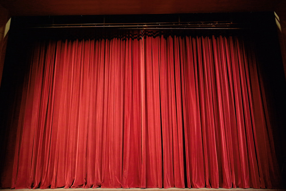 Closed red stage curtain