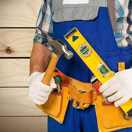 man holding hammer and level.jpg