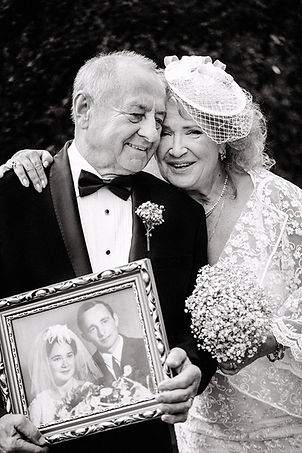 grandmother and grandfather holding thei