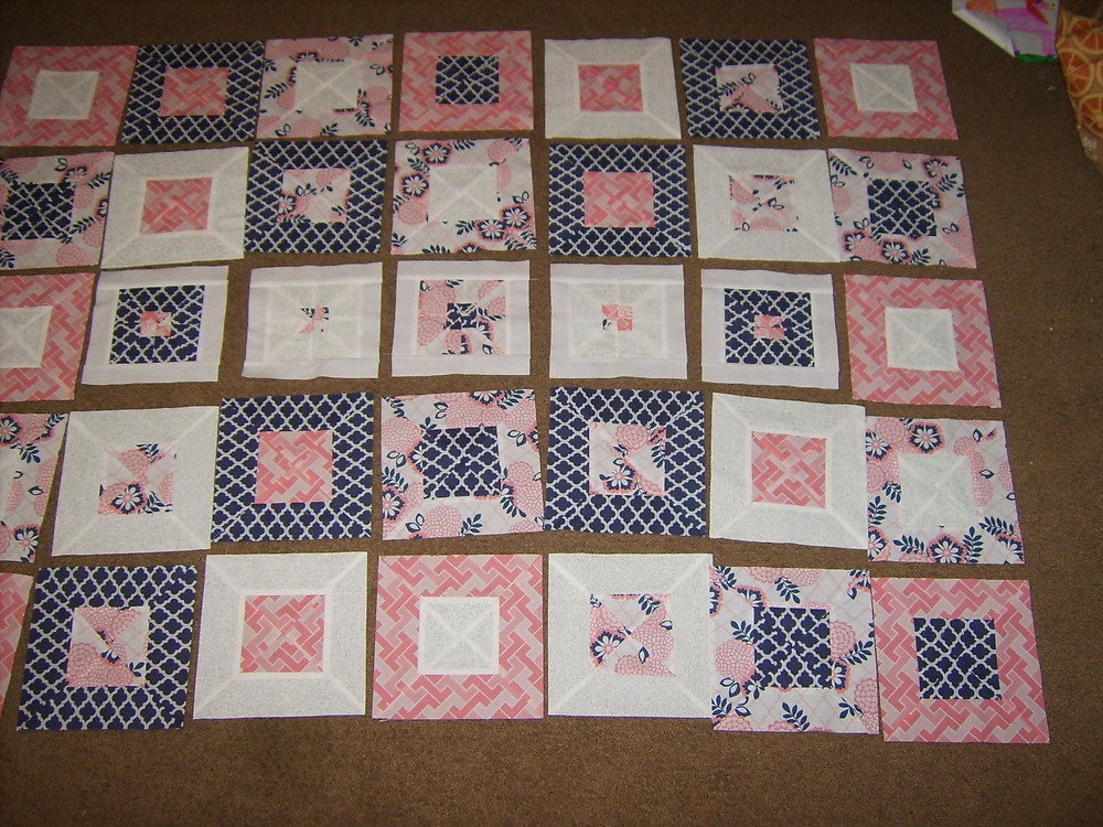 Blocks all laid out for the first quilt.  Just needed a final border around each block then sewing together.