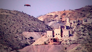 """A spaceship descends into a mining town in the film """"Mirza the Miraculous"""" by Brent Joseph"""