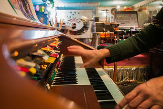 """The hands of musican Quintron are seen playing an analog keyboard as he records the soundtrack Brent Joseph's film """"Mirza the Miraculous"""""""