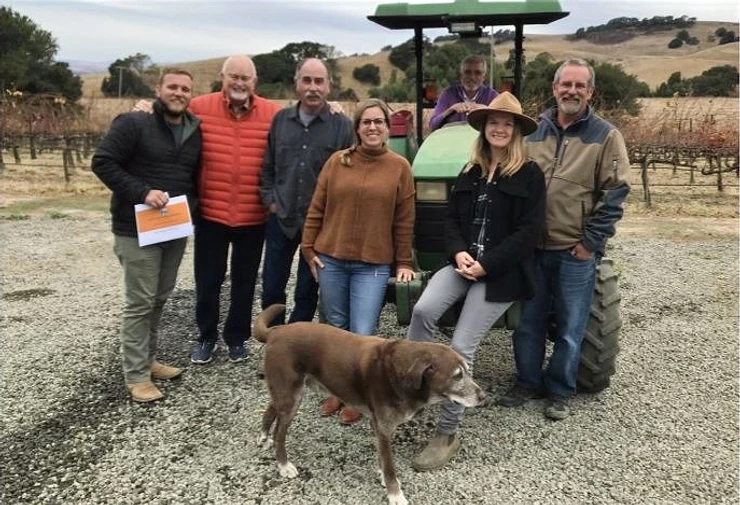 Save the Family Farms Napa Valley is seeking a micro winery designation that would allow wine tasting and sales at small farms. Meeting recently were (left to right) Zach Smith of Calistoga's Barlow Vineyards; Terry Scott, Ken Nerlove, Elise Nerlove, George O'Meara, Hayley Hossfeld and Barr Smith. Photo by Pat Hampton..