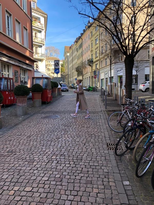 girl walking on cobblestones europe