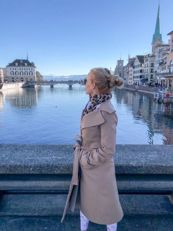 girl overlooking limmat river zurich switzerland