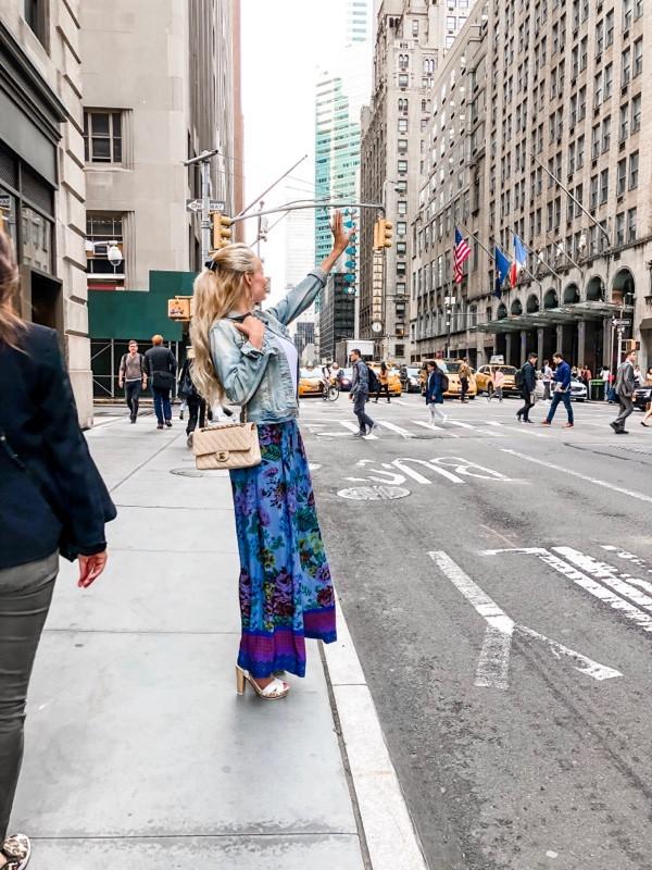 girl hailing cab in new york city