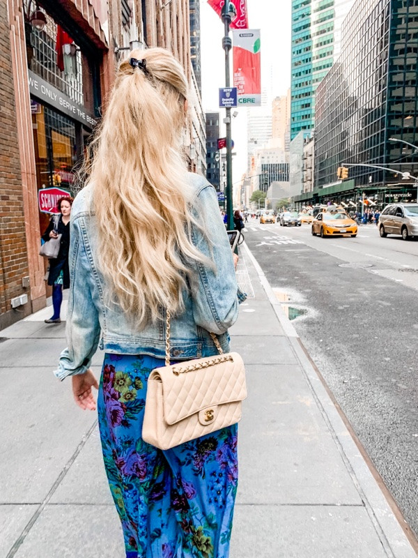 girl in nyc with long hair and chanel bag